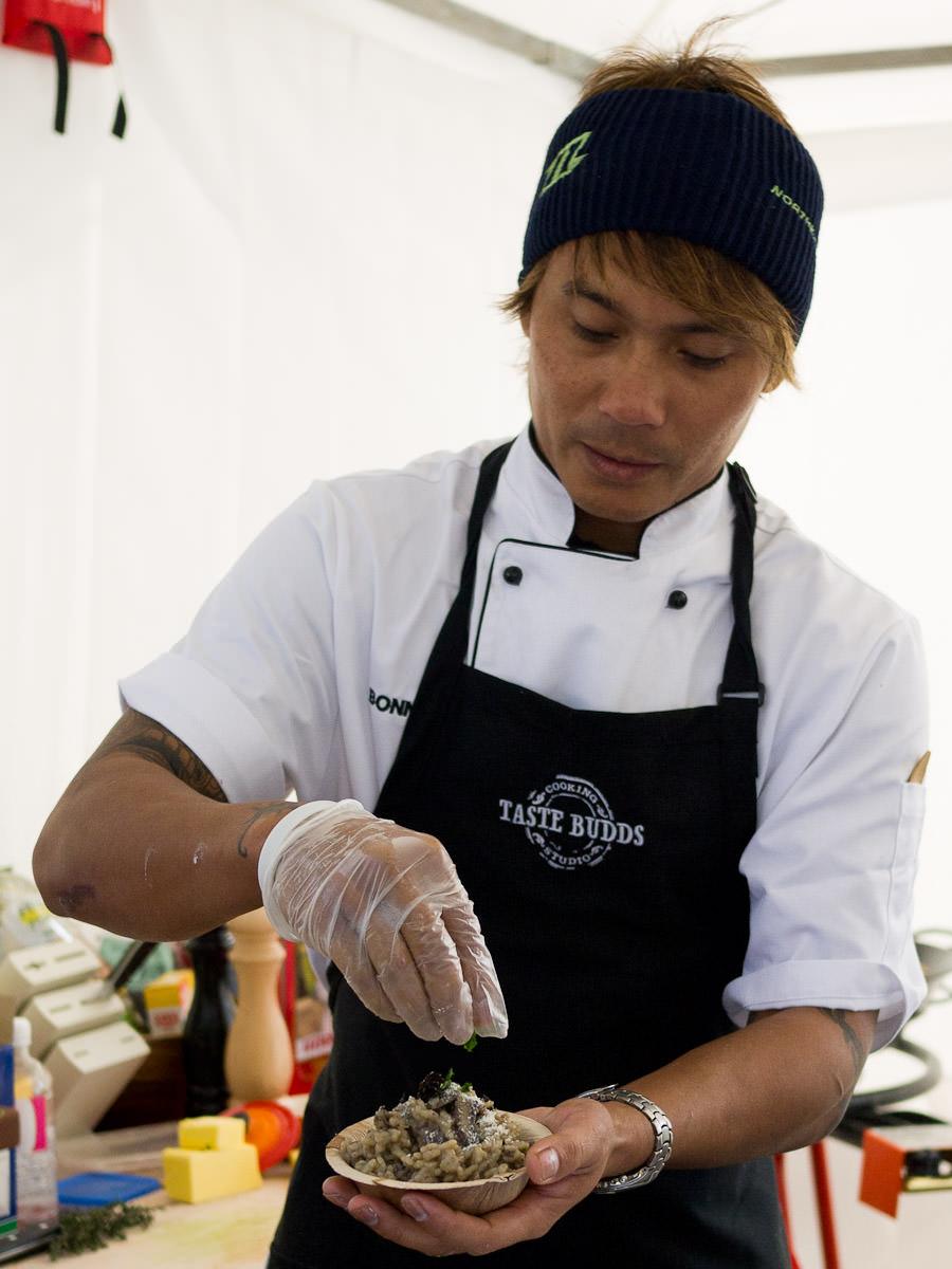 Garnishing truffle risotto, Taste Budds Cooking Studio