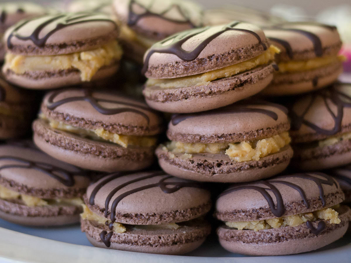 Chocolate macarons with white chocolate peanut butter ganache - close-up