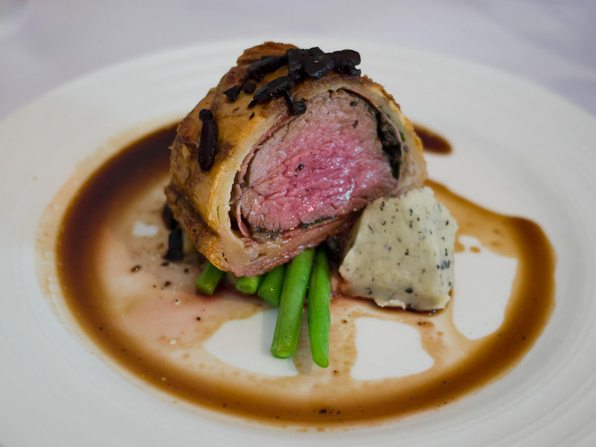 Beef Wellington with a twist, truffled mash, aged black garlic jus