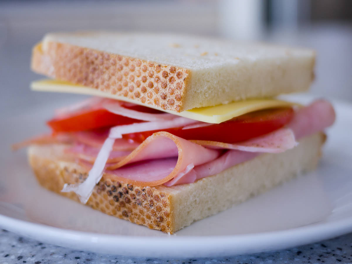 Ham, cheese, tomato and onion sandwich