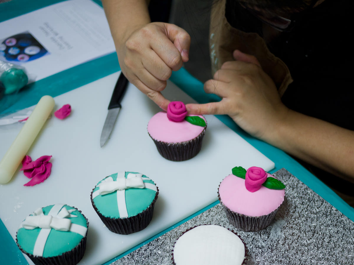 Me working on a fondant rose (photo by Winnie Lee)