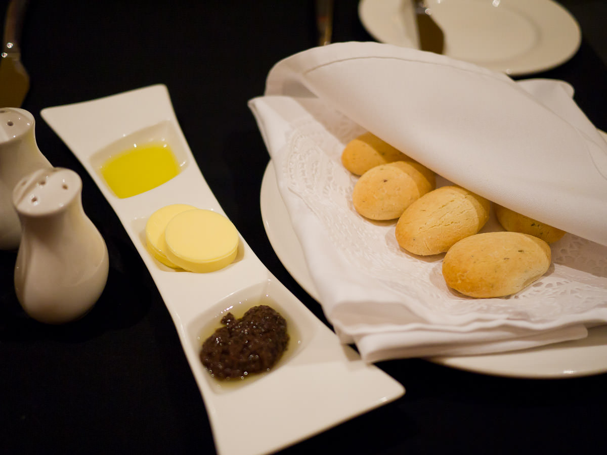 Parmesan bread with butter, olive oil and olive tapenade