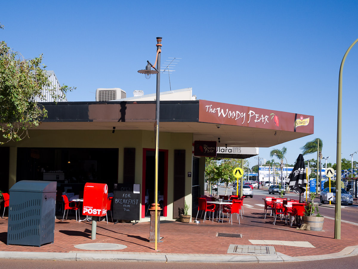 Ample seating outside at The Woody Pear, Victoria Park. Car yards across the road.