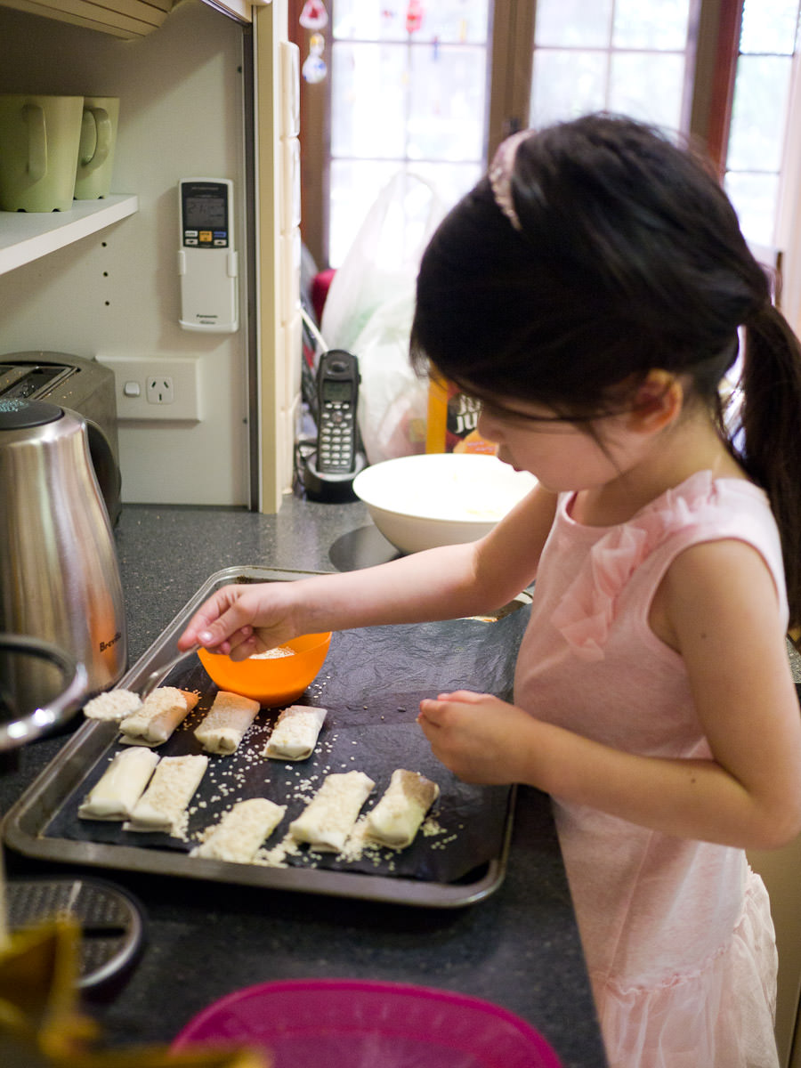Ruby tops the pastries with sesame seeds
