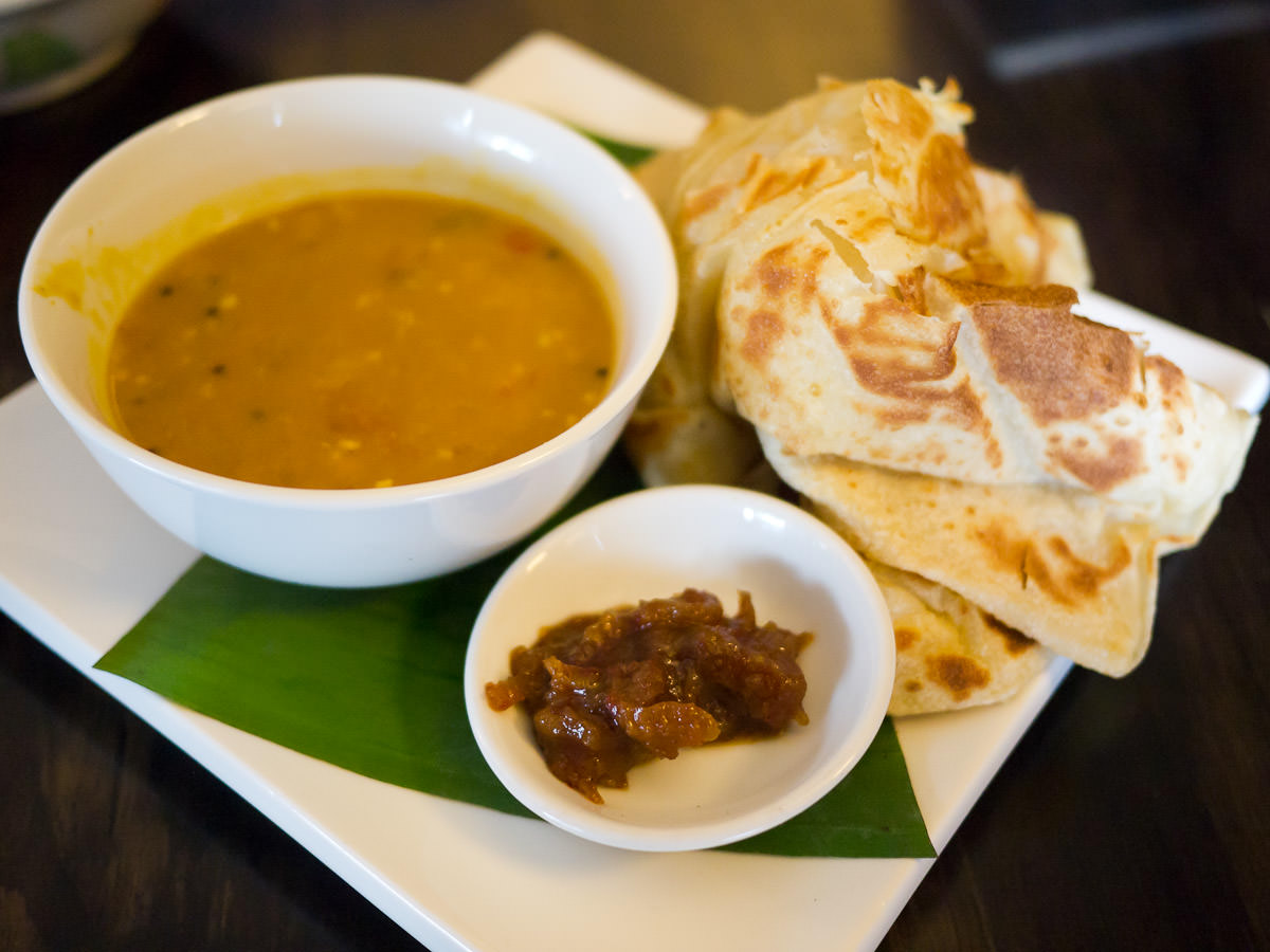 Roti canai with dhal and sambal