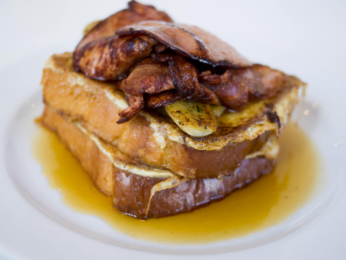 French toast of brioche with caramelised banana, bacon and maple syrup (AU$18)