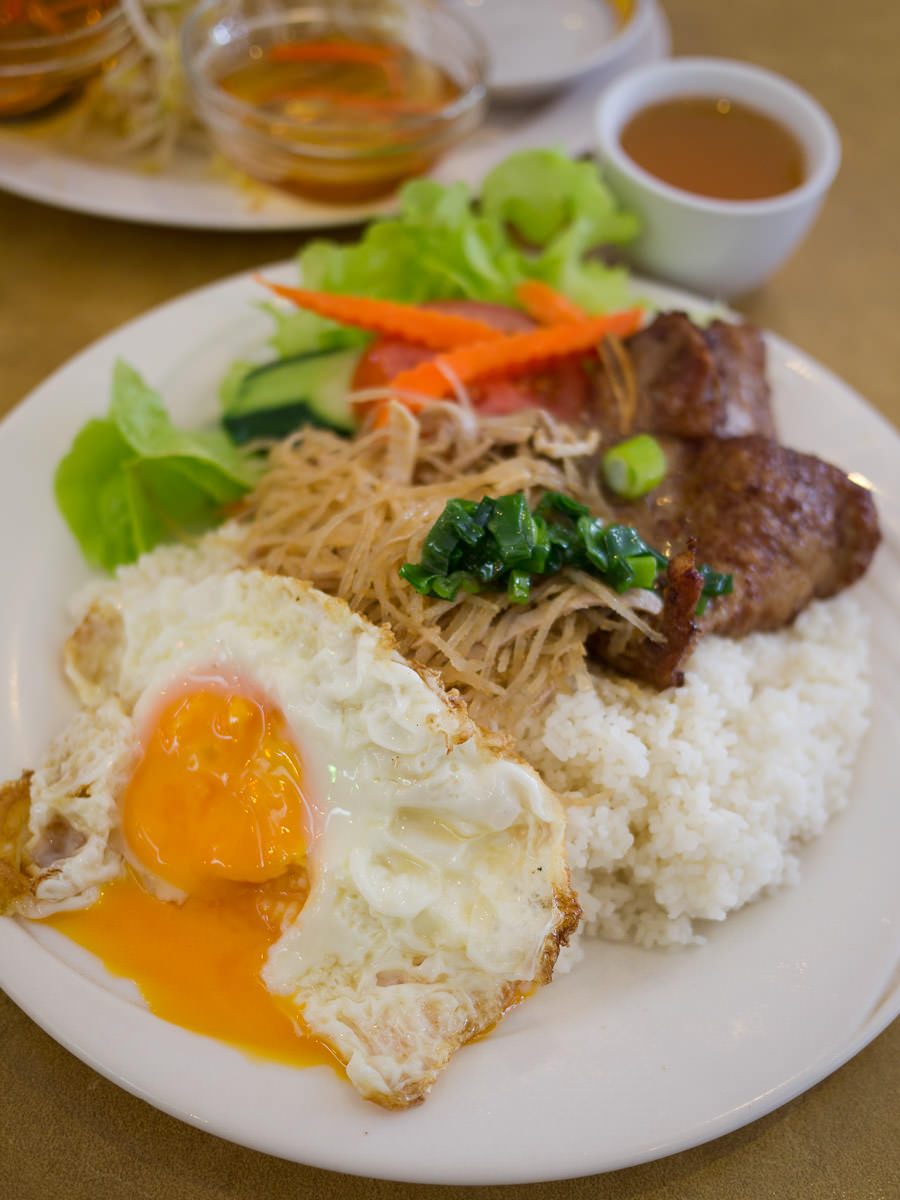 Broken rice with pork chop, shredded pork and fried egg (AU$10)
