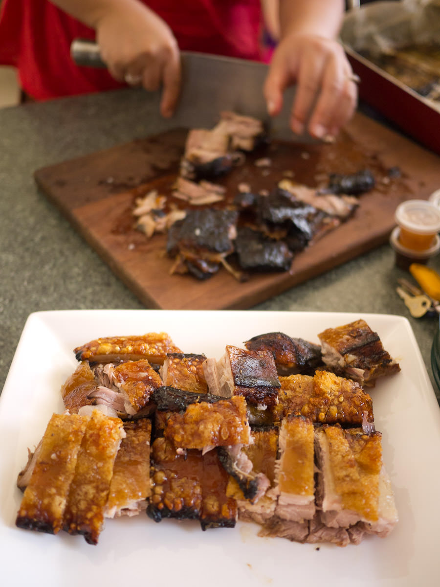 Chopping up the roasted pork belly