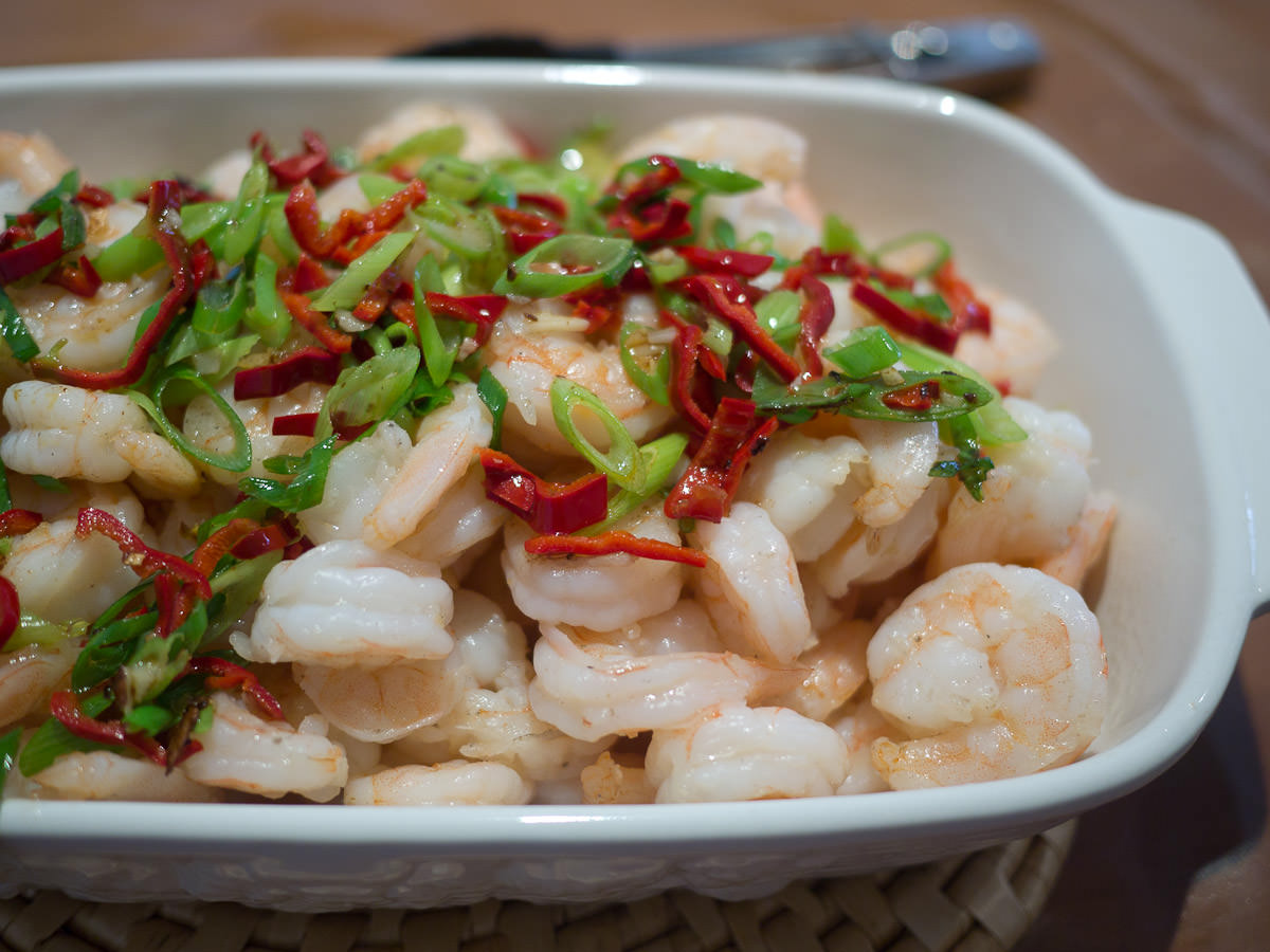 Prawns with garlic and ginger, garnished with homegrown chilli
