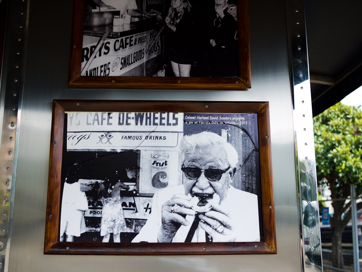Photograph of Colonel Sanders eating a pie at Harry's Cafe de Wheels, 1972
