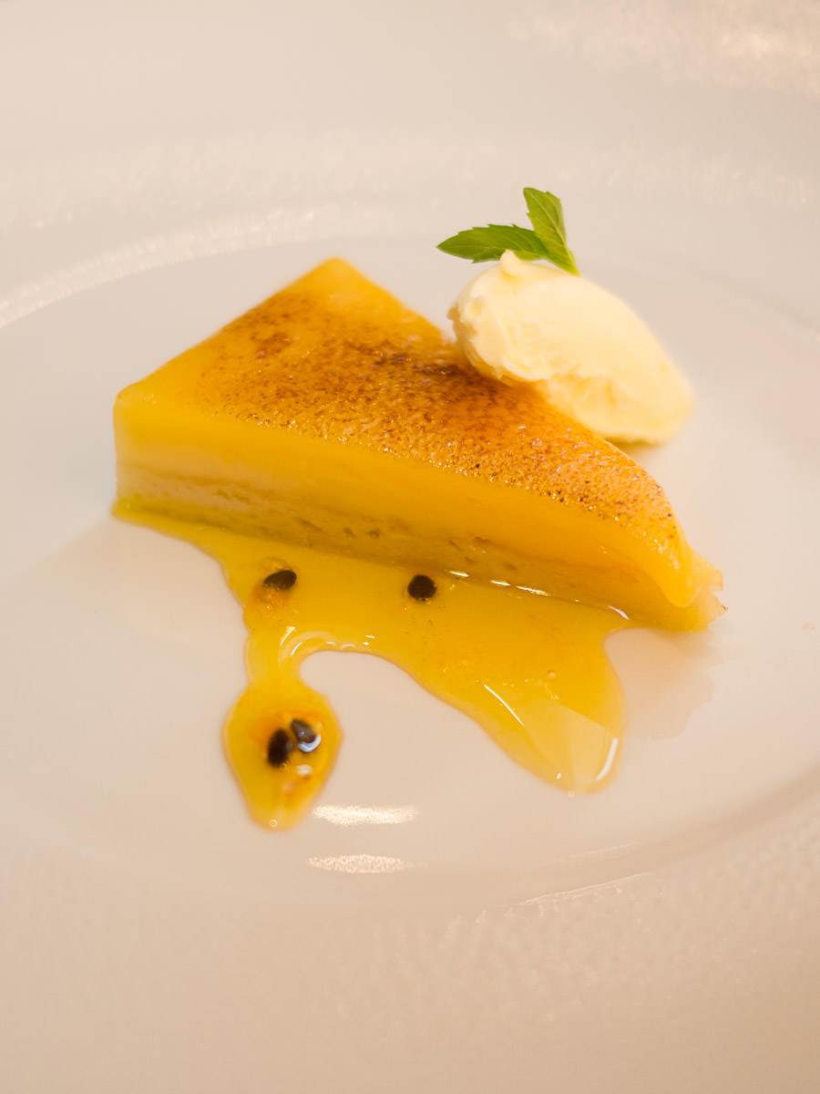 Pineapple & Malibu tart, rum syrup, double cream