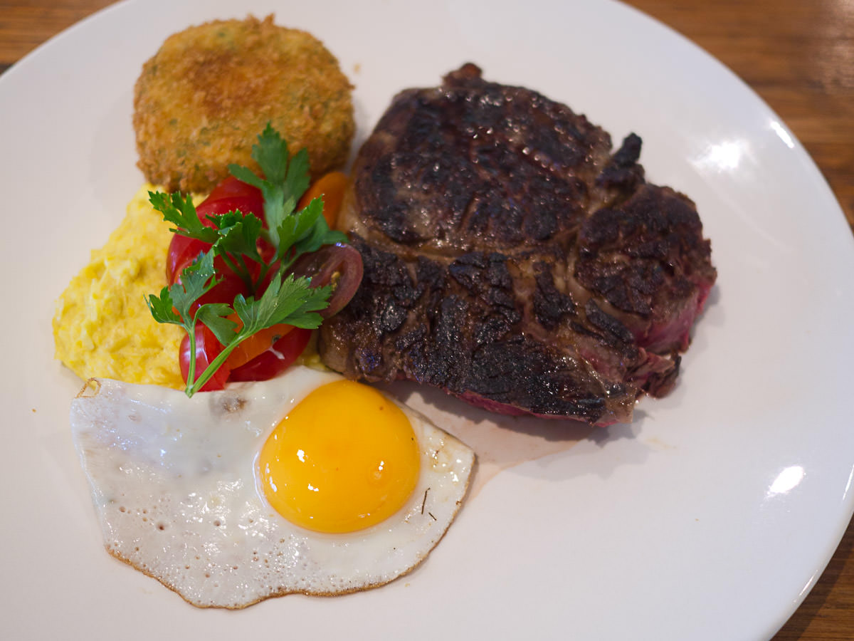 Grilled steak, creamed corn, bubble and squeak, fried egg and tomato relish (AU$23)
