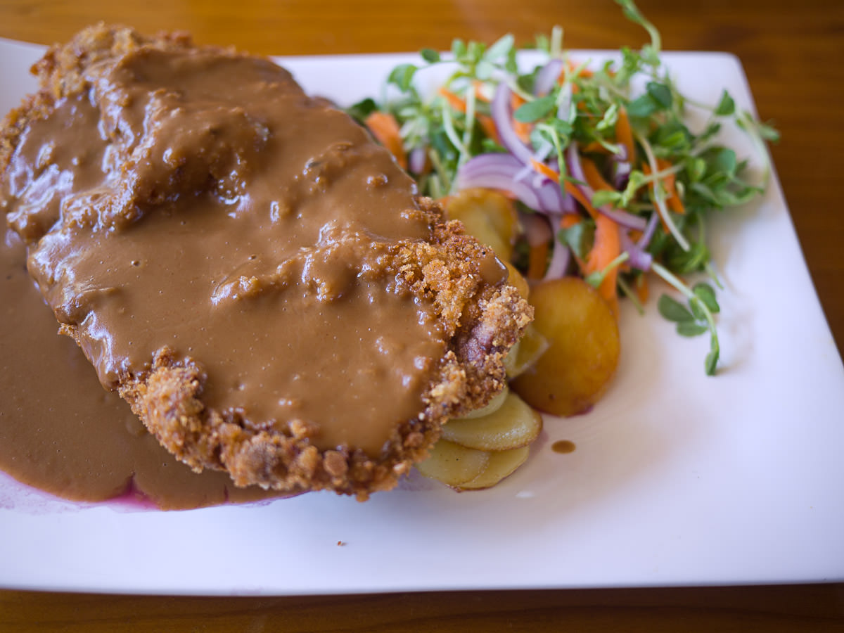 Veal schnitzel topped with creamy mushroom sauce served with red  cabbage and pan fried potatoes (AU$31)