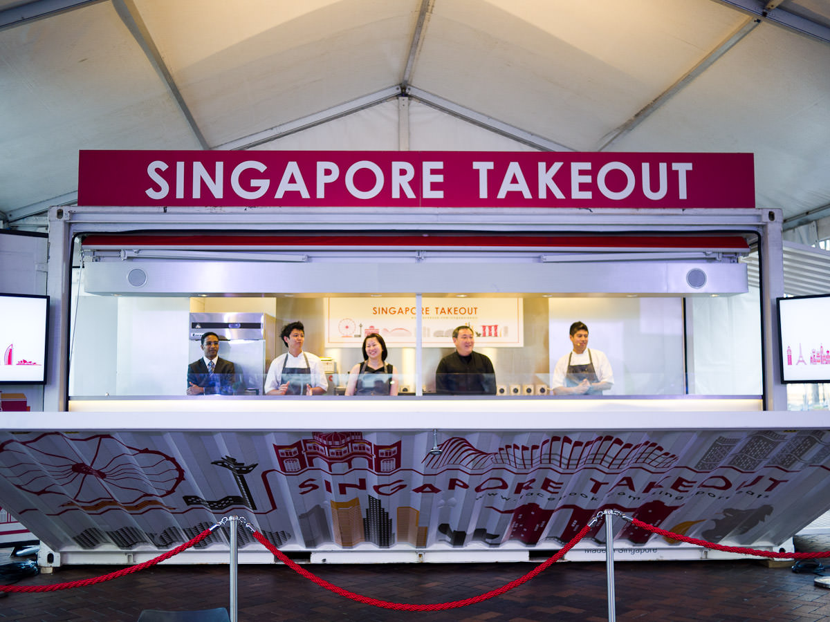 The sea container opens to reveal the Singapore Takeout crew