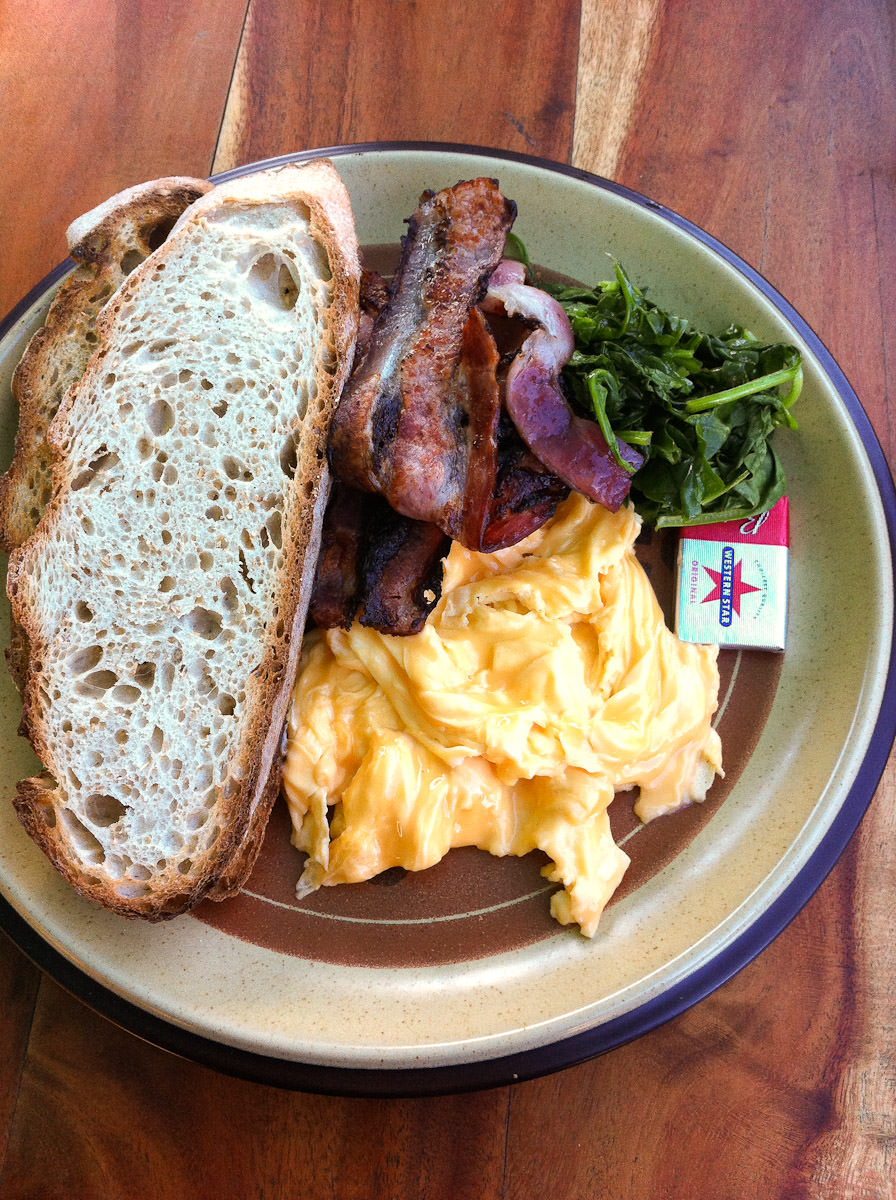 Bacon, scrambled eggs, spinach and toast
