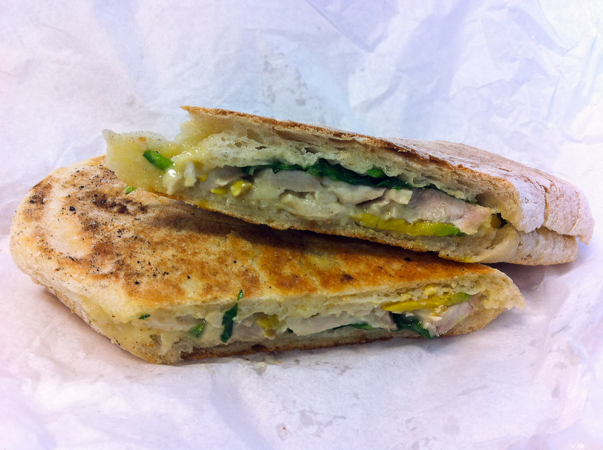 Toasted panini with chicken, Brie, avocado and spinach