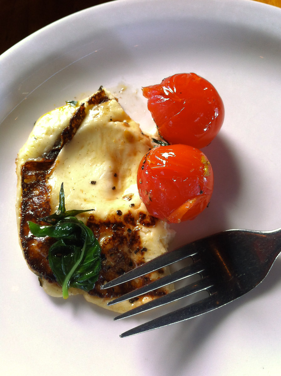 Grilled haloumi, cherry tomatoes, basil