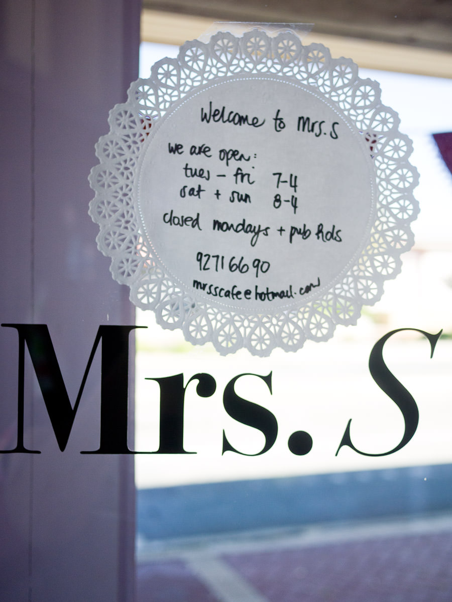 Mrs. S' contact details and opening hours are displayed on a doily