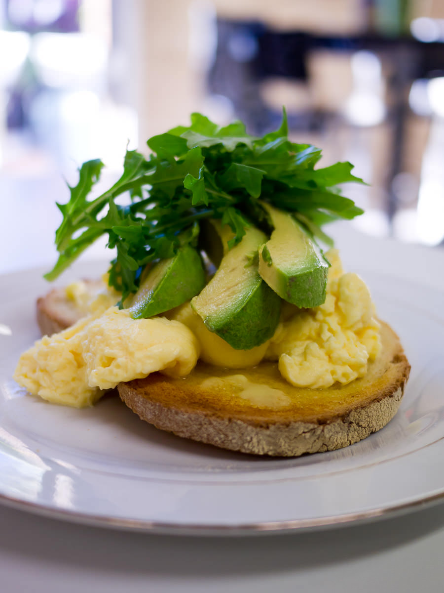 Scrambled eggs and avocado with toast
