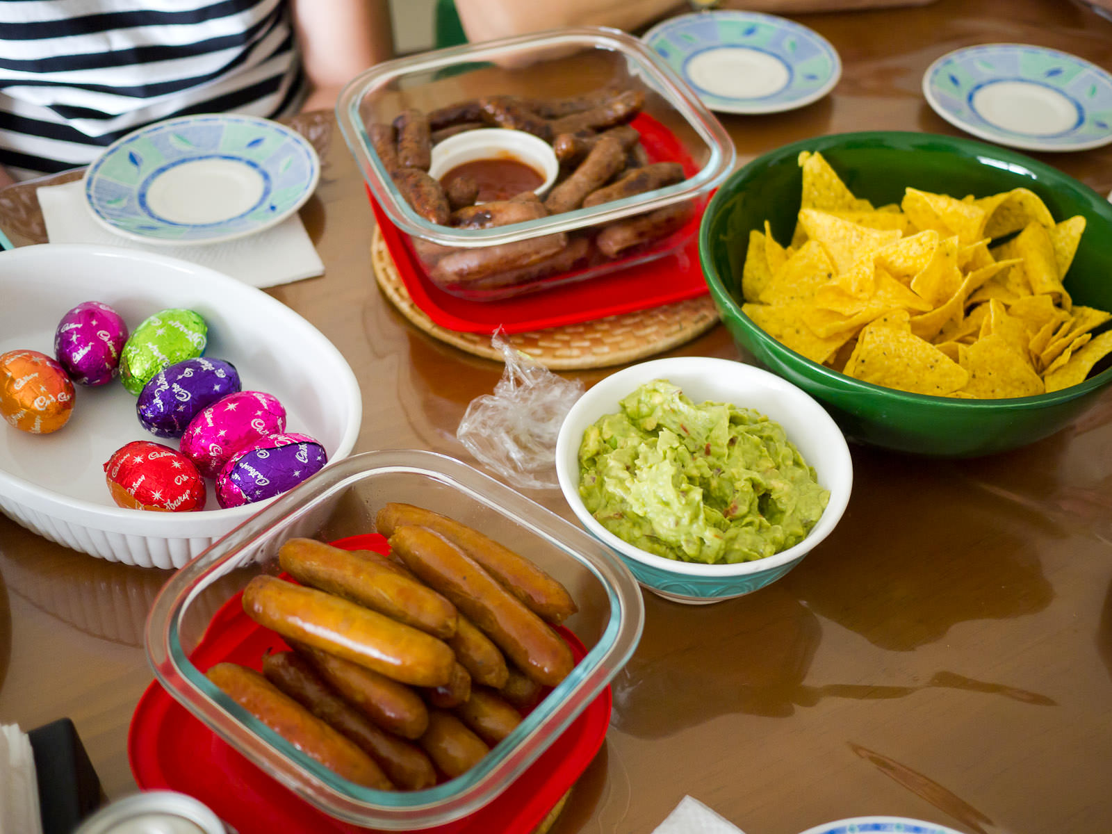 Easter eggs, Mexican beef, plain beef and curry sausages, guacamole and corn chips