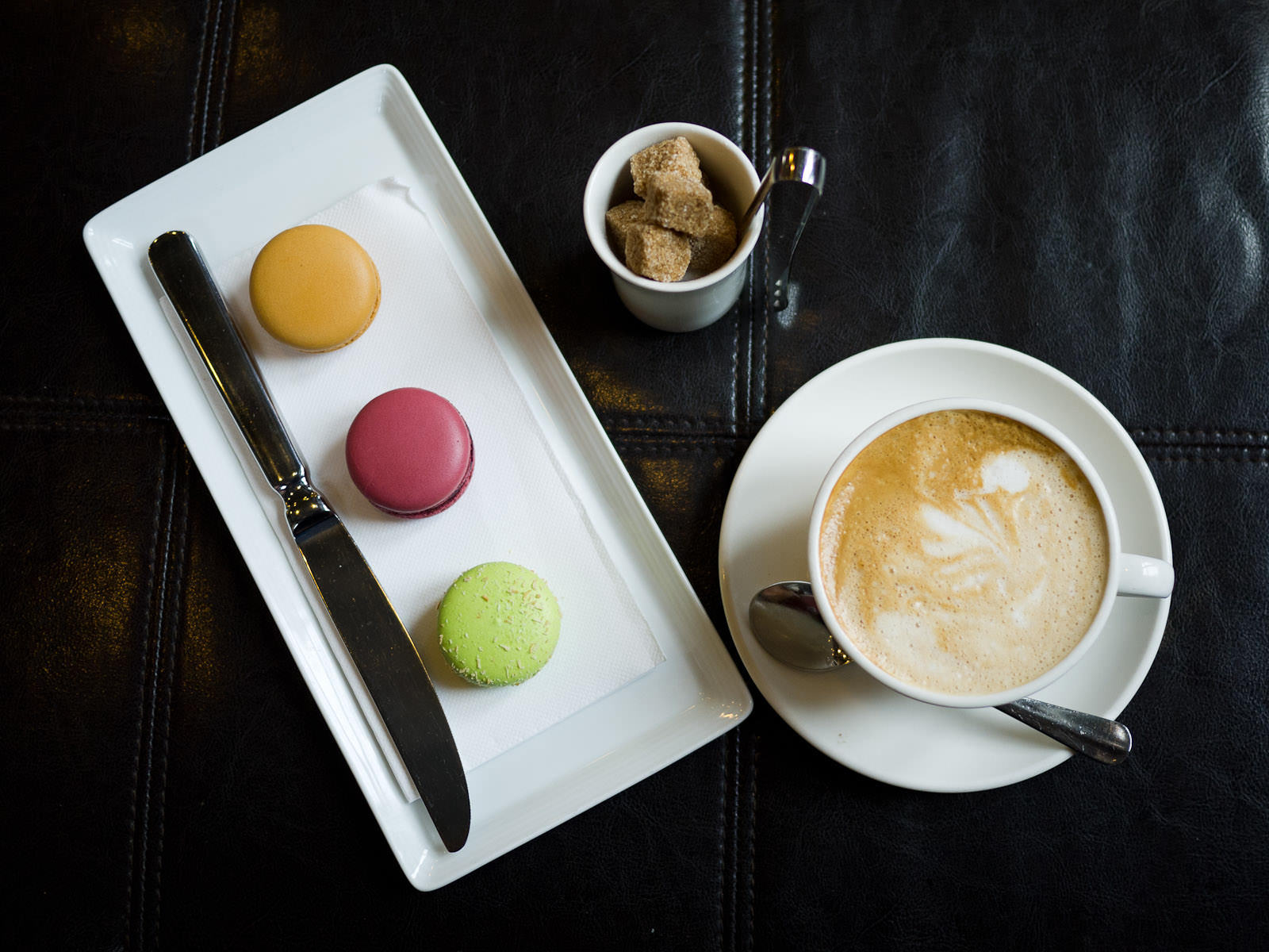 Salted caramel, blackcurrant and lime, mango and coconut macarons, soy flat white