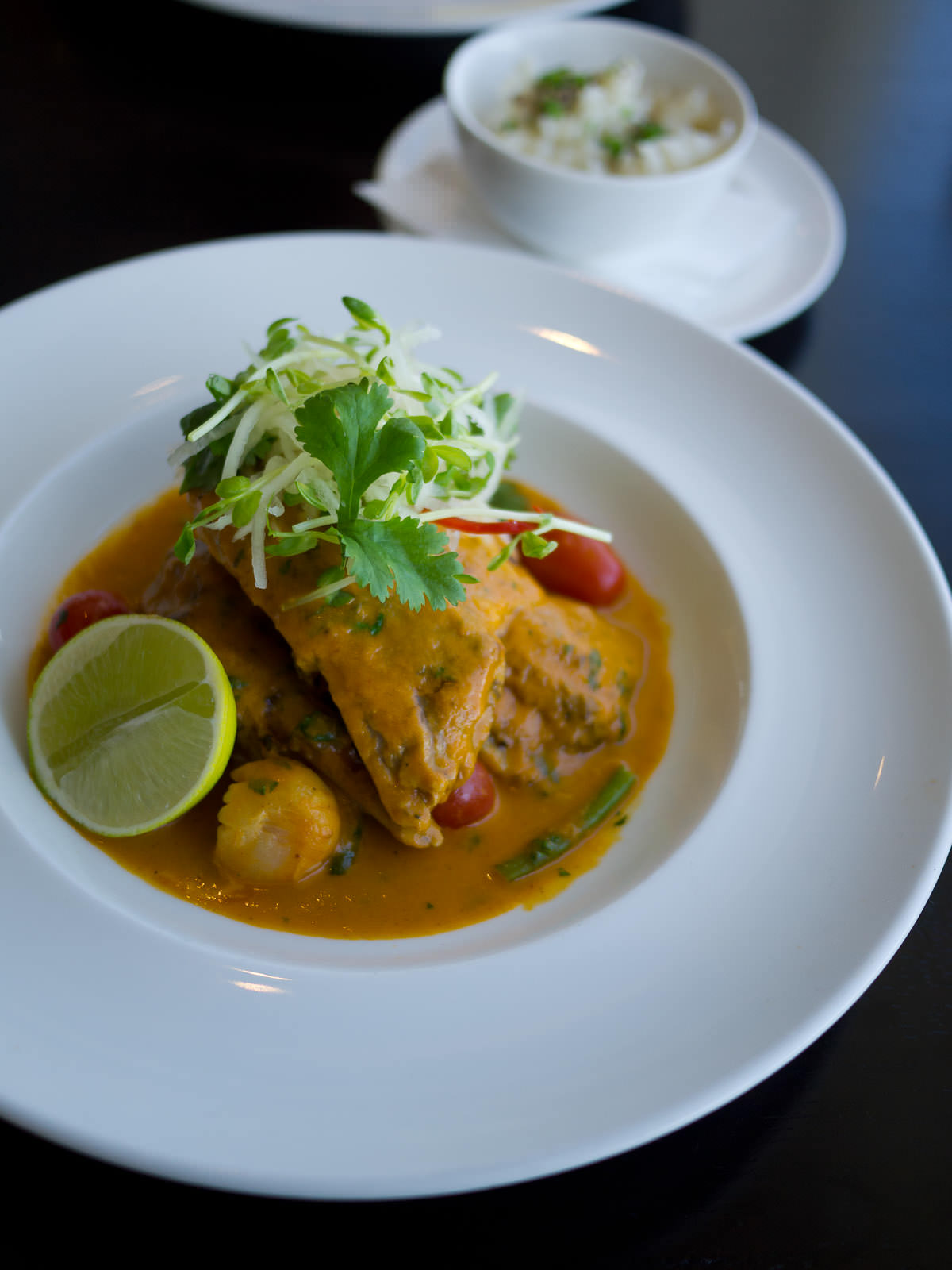 Double roasted duck, slow roasted in rich Thai curry sauce with lychees, tamarind, lemongrass & coconut rice (AU$45.50)