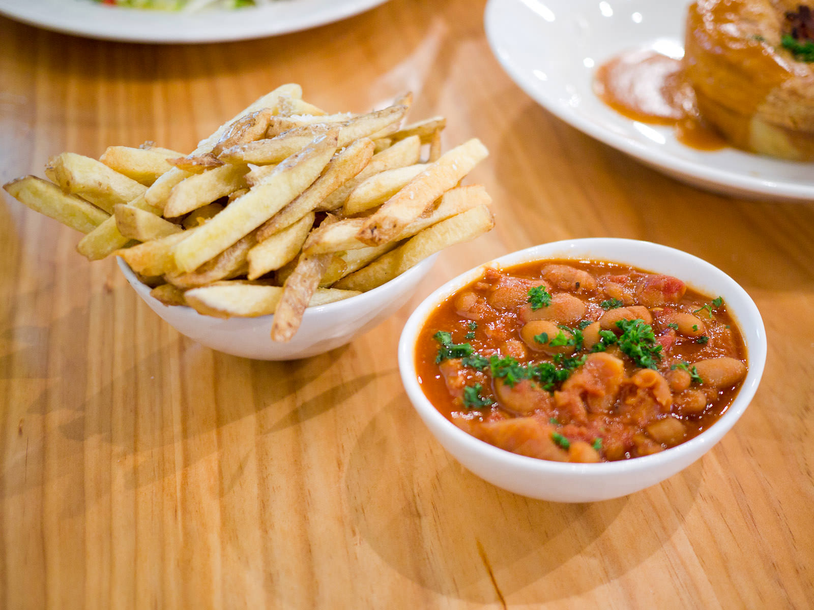 Hand cut chips (AU$4.50) and baked beans with smoked ham hock (AU$5)