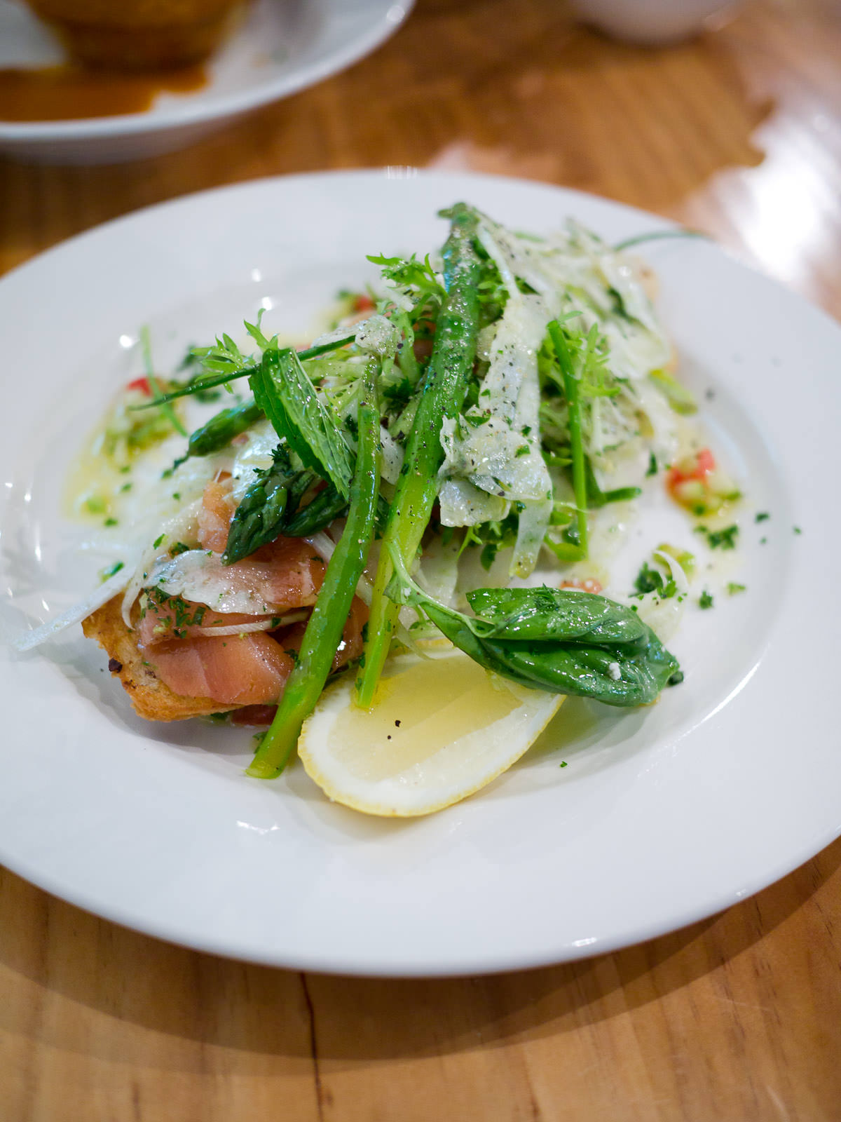 Ciabatta with Tasmanian smoked salmon, lemon ricotta, asparagus and fennel salad (AU$17)