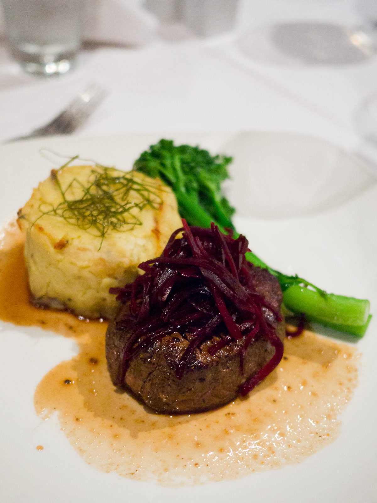 250g eye fillet with cabernet merlot jus, potato rösti scented with thyme, garlic buttered broccolini and beetroot pickles