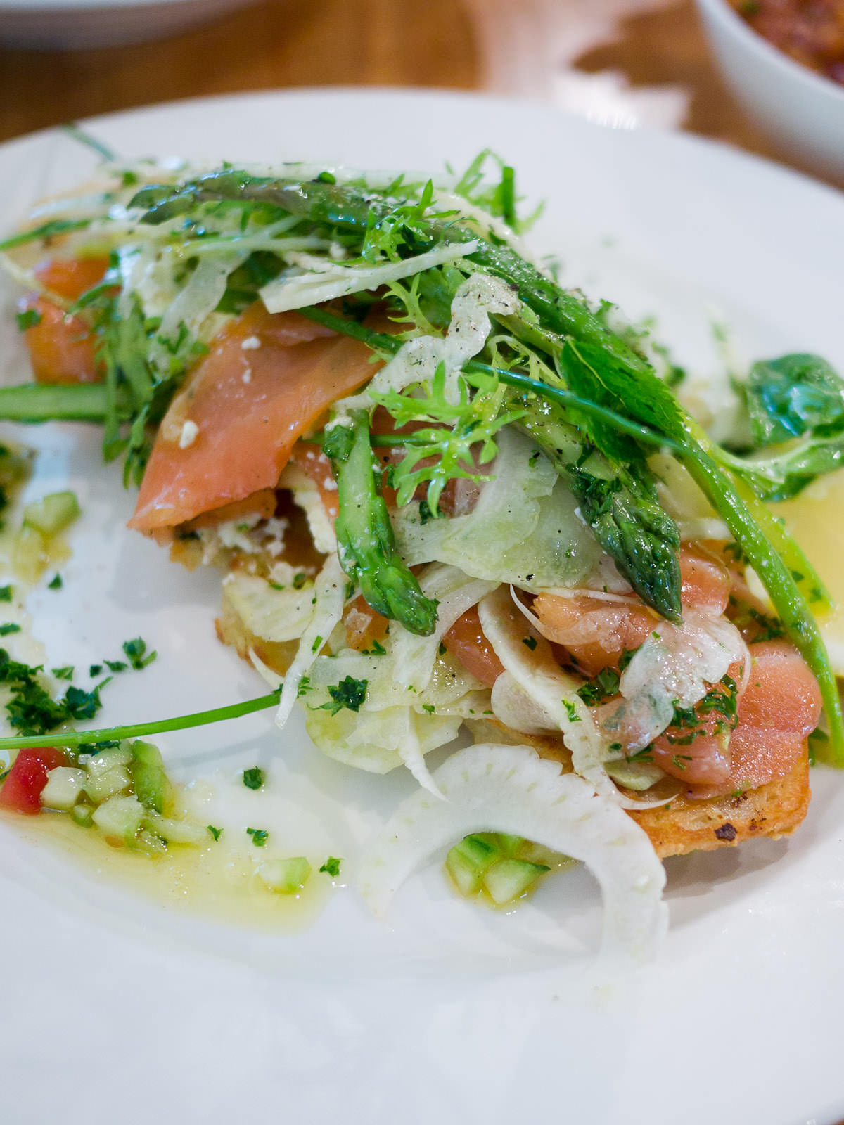 Ciabatta with Tasmanian smoked salmon, lemon ricotta, asparagus and fennel salad - close-up