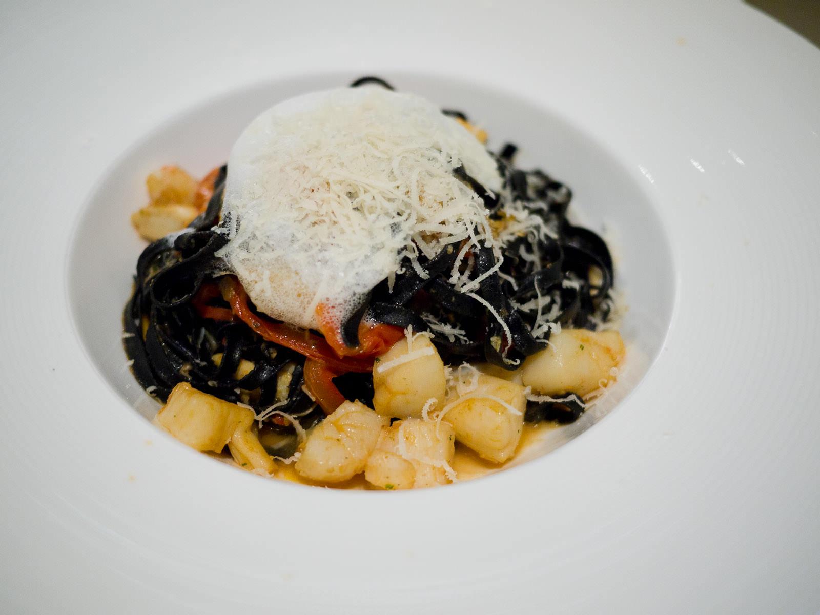 Black ink fettuccine, crab, scallops, red capsicum, white wine, garlic and chilli, AU$30