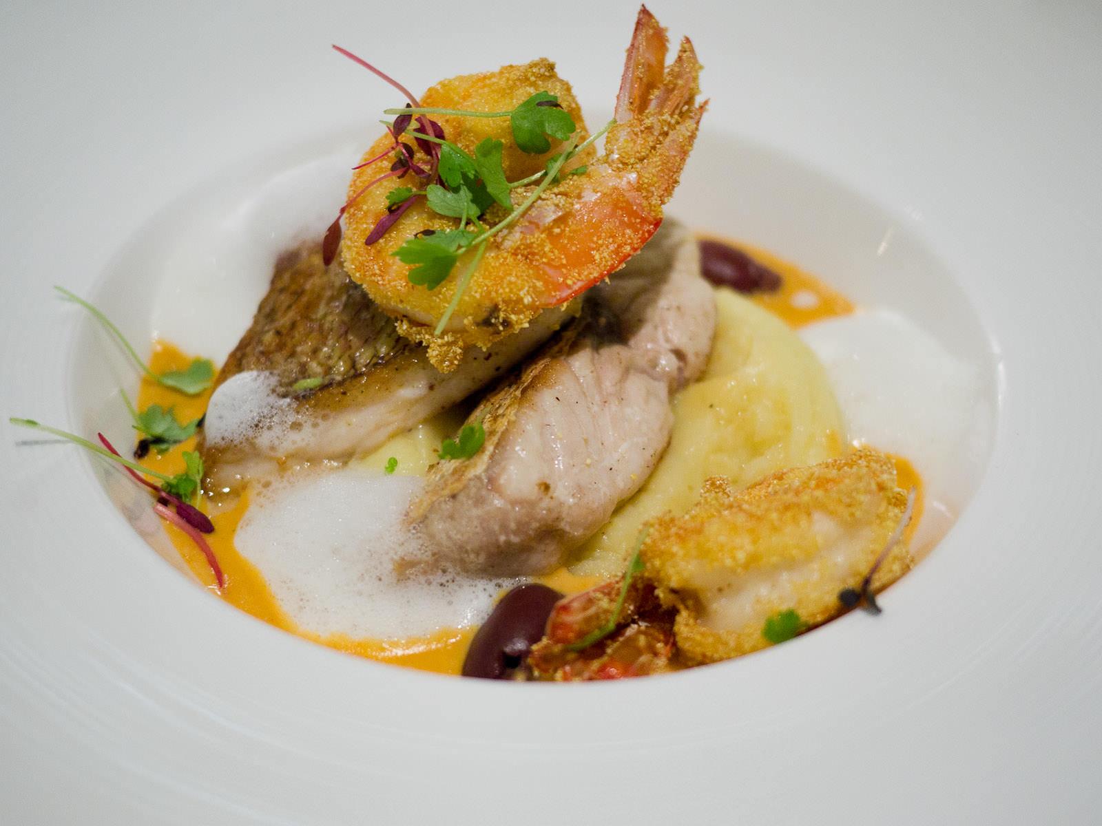Pan-fried snapper, lobster bisque, black olives and deep fried prawns coated in polenta flour, AU$41