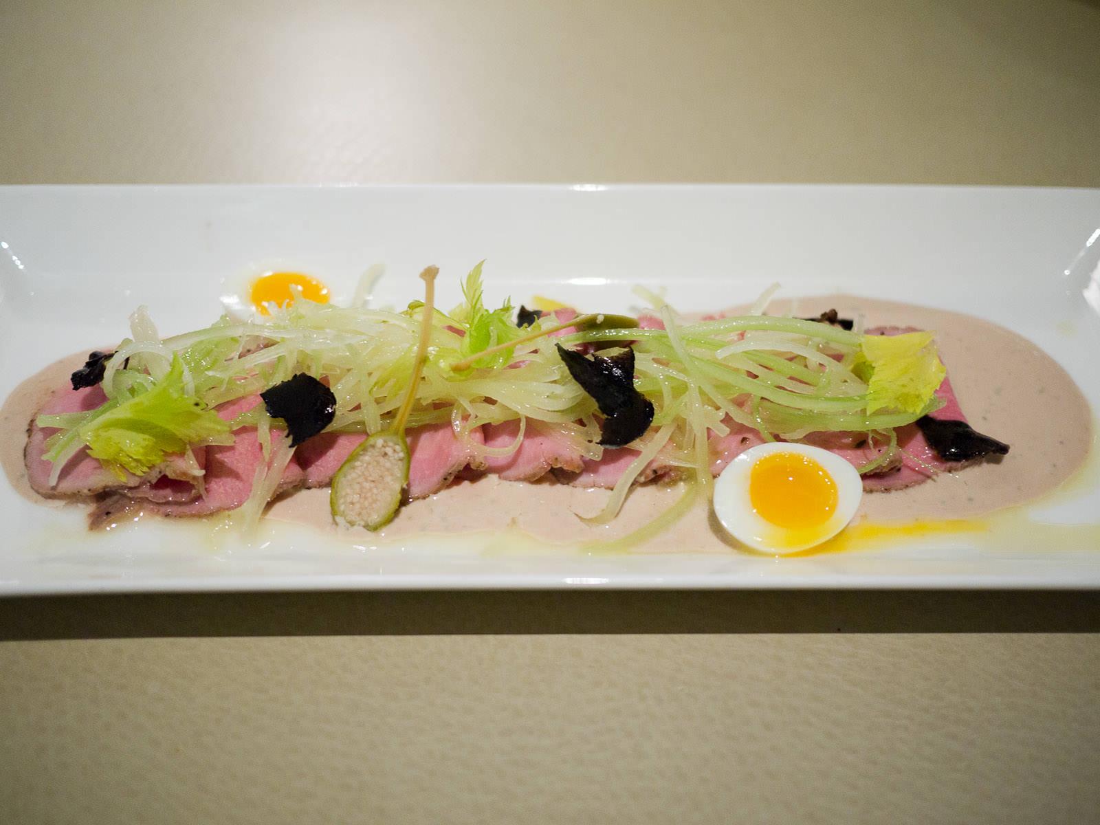 Roasted veal in tuna caper sauce with crispy celery salad, quail egg, black truffle, AU$25