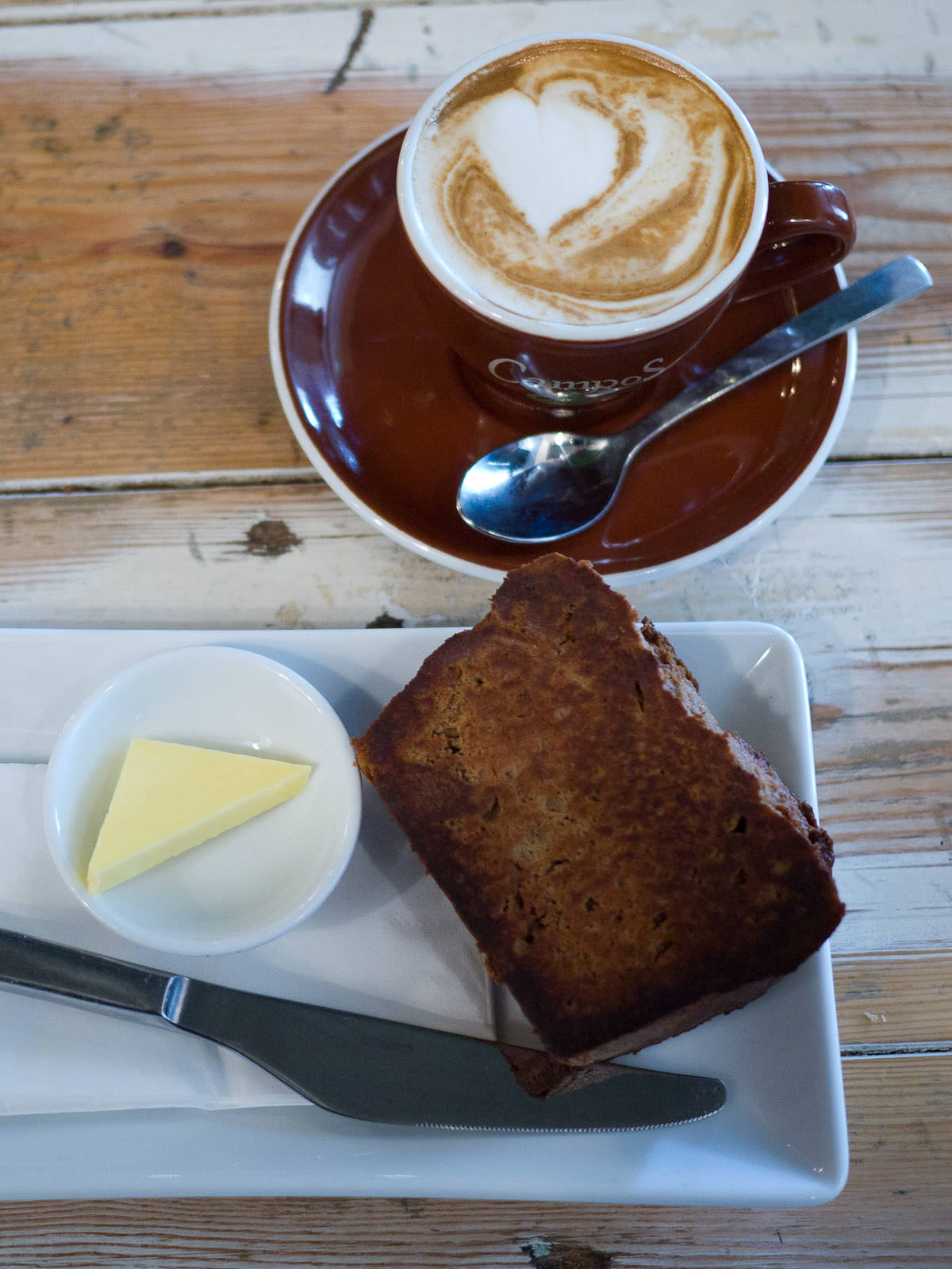 Banana bread with butter and my second soy flat white