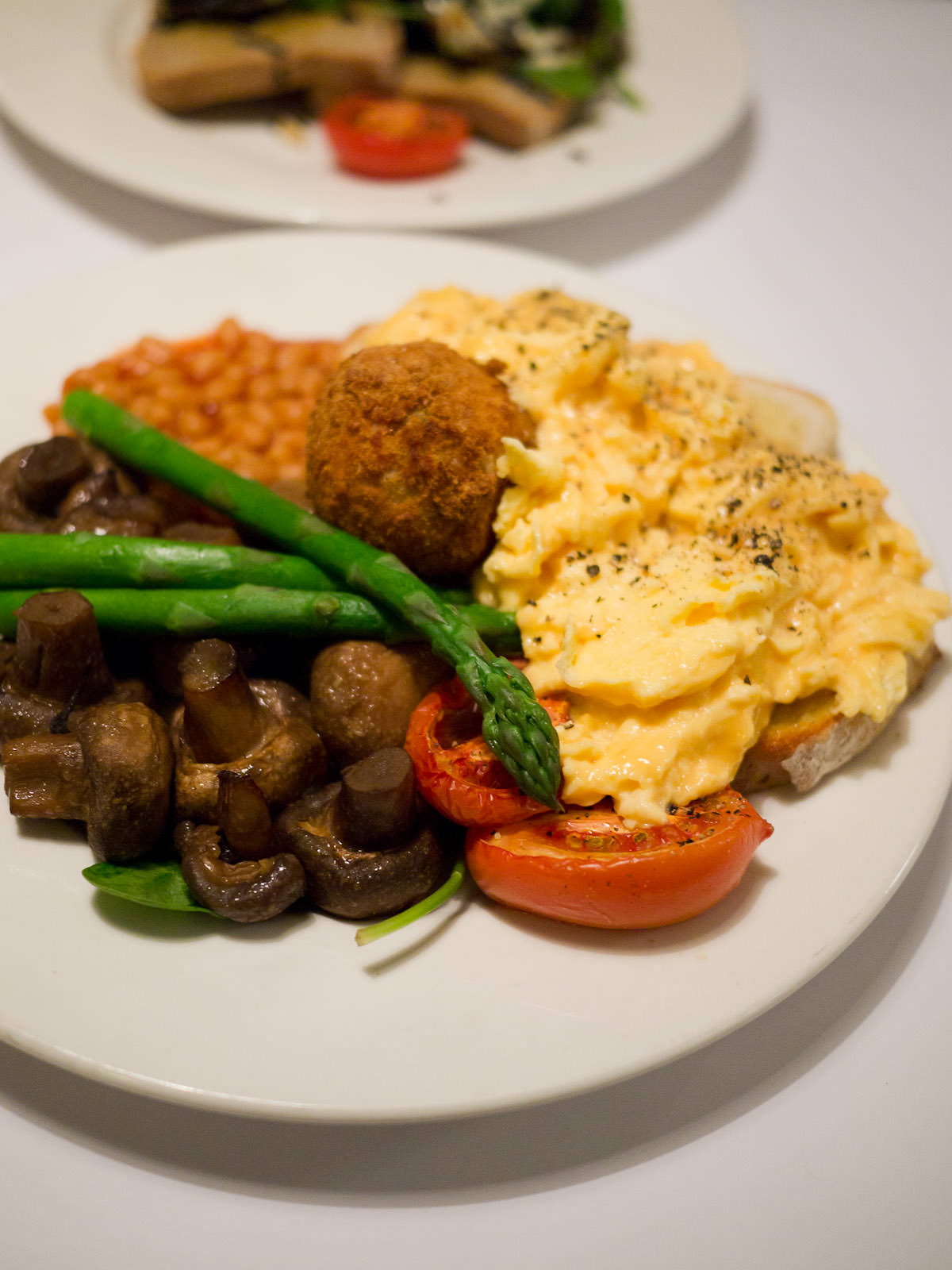 Vegetarian full breakfast - eggs, potato, tomato, baked beans, asparagus, spinach, mushrooms (AU$19.50)