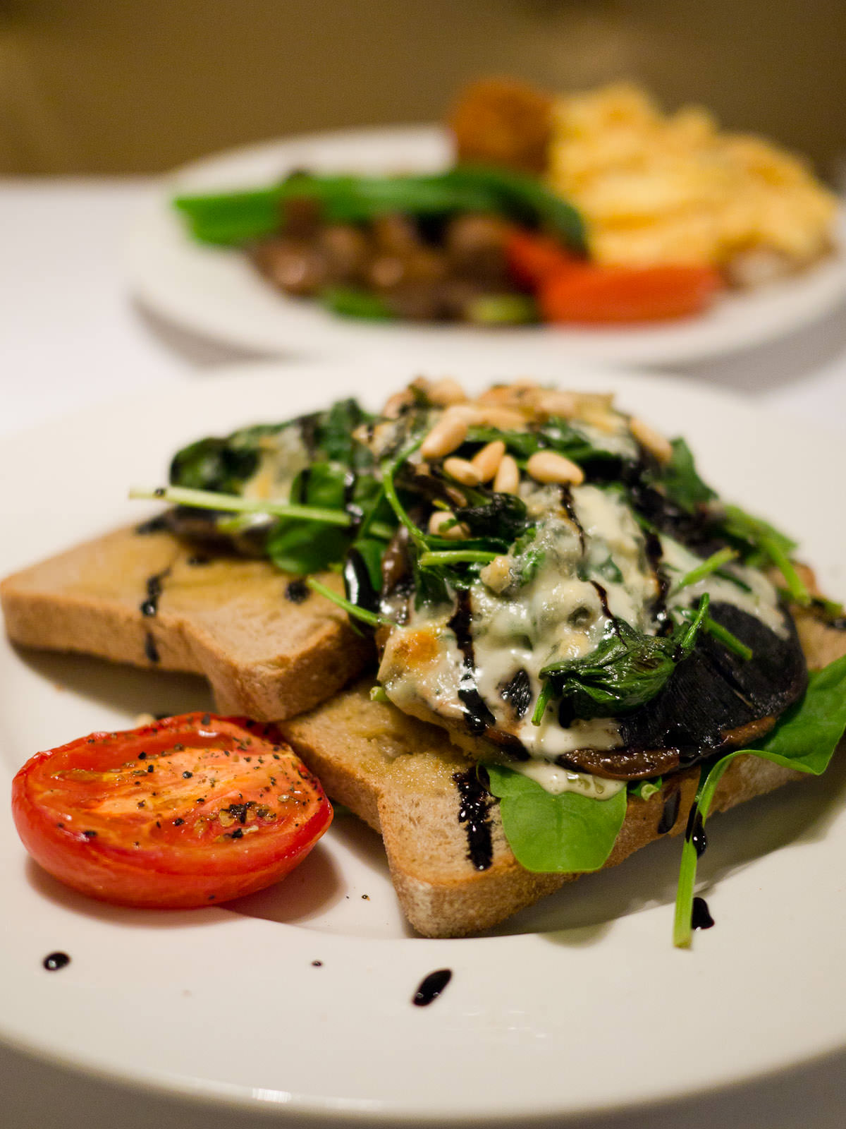 Grilled field mushrooms on rye with blue cheese, spinach, balsamic vinegar and roasted pine nuts (AU$18.10)