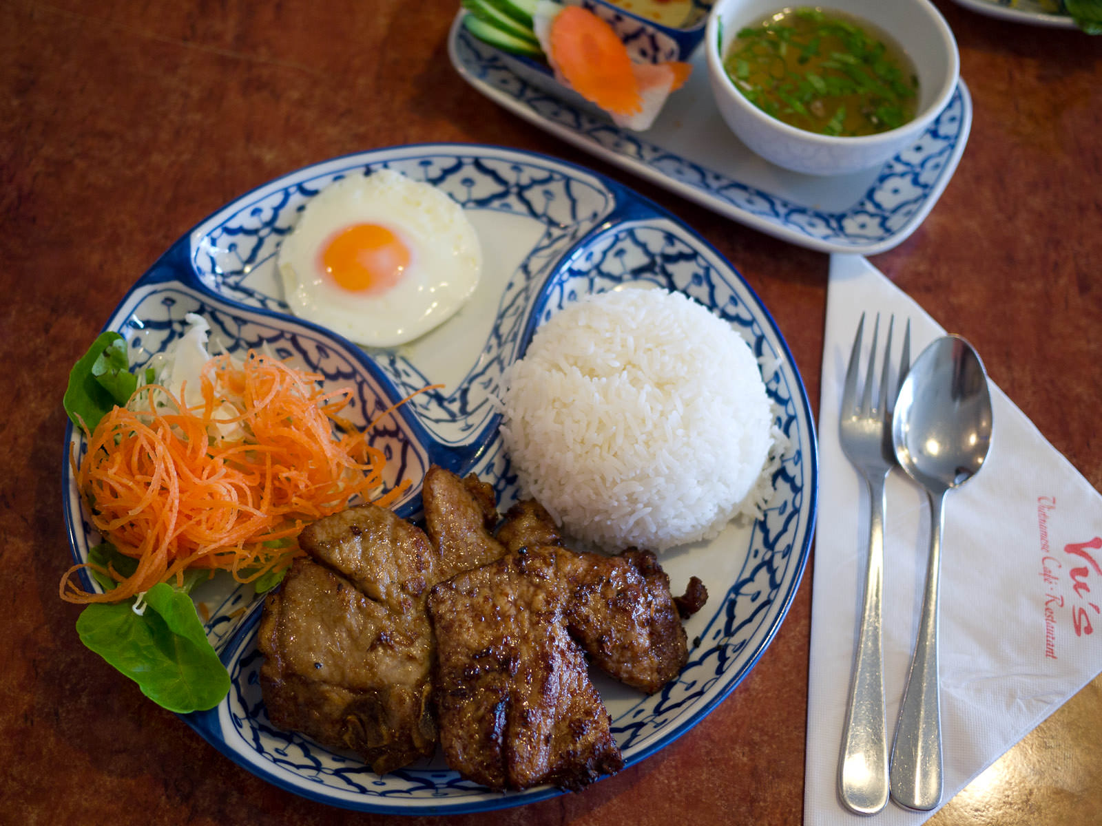 Com suong (Charcoal grilled pork chop, fried egg, rice and soup - AU$13.50)