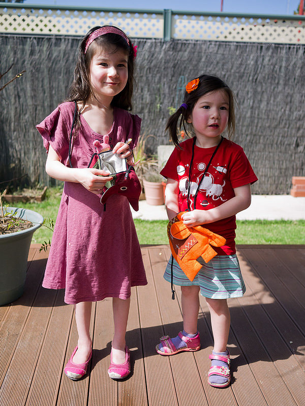 Two little girls with their new elephant bags