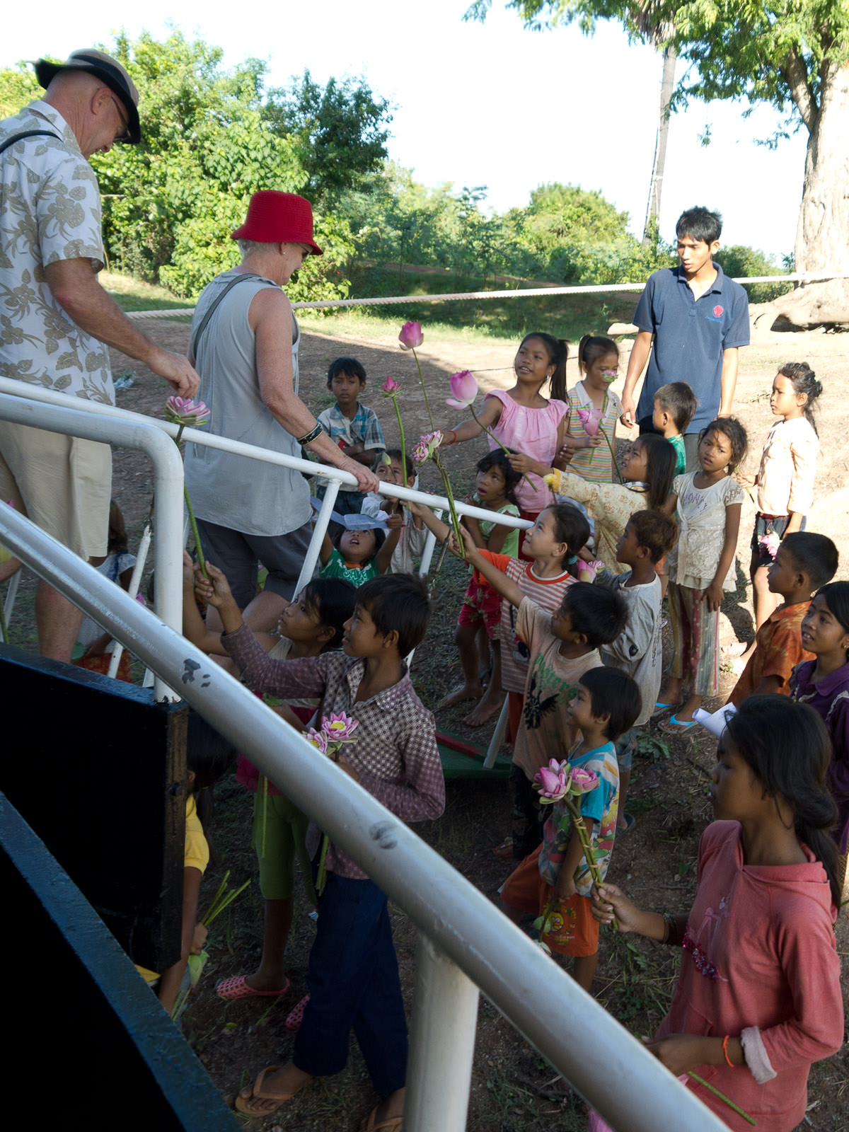 Disembarking the ship - greeted by village kids