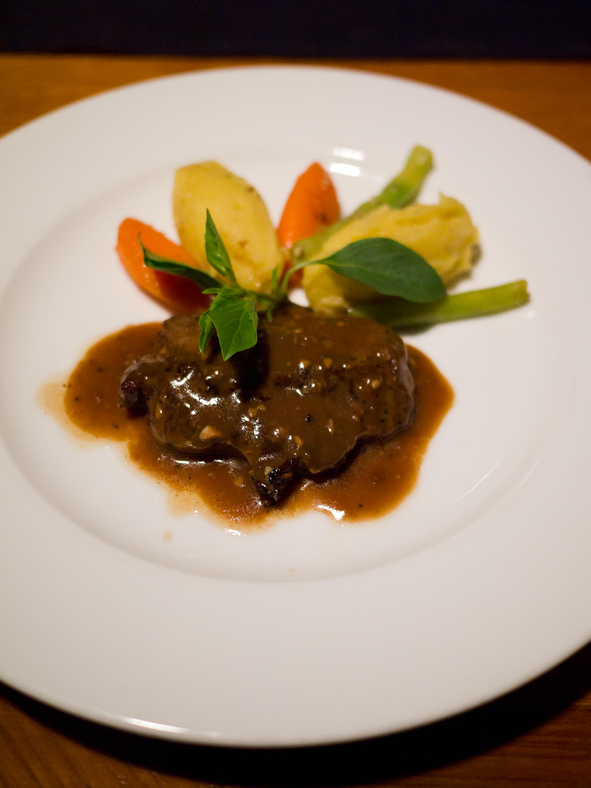 Ostrich with Kampot pepper sauce with potato mash and vegetables