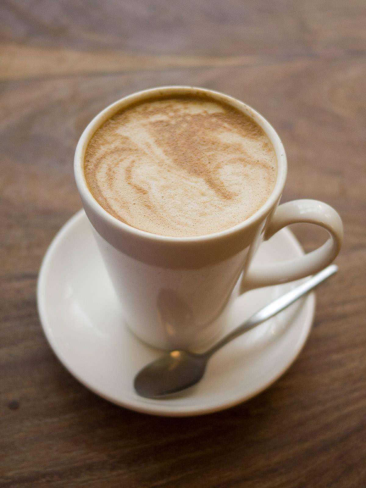 Soy flat white in a mug
