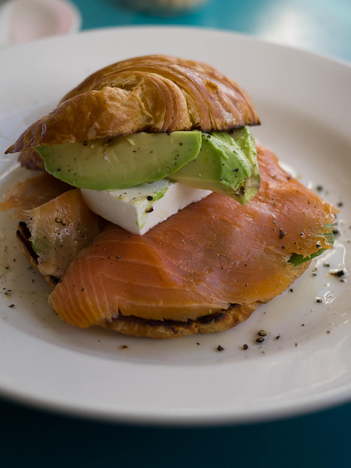 Croissant with smoked salmon, feta, spinach and avocado (AU$11.50)