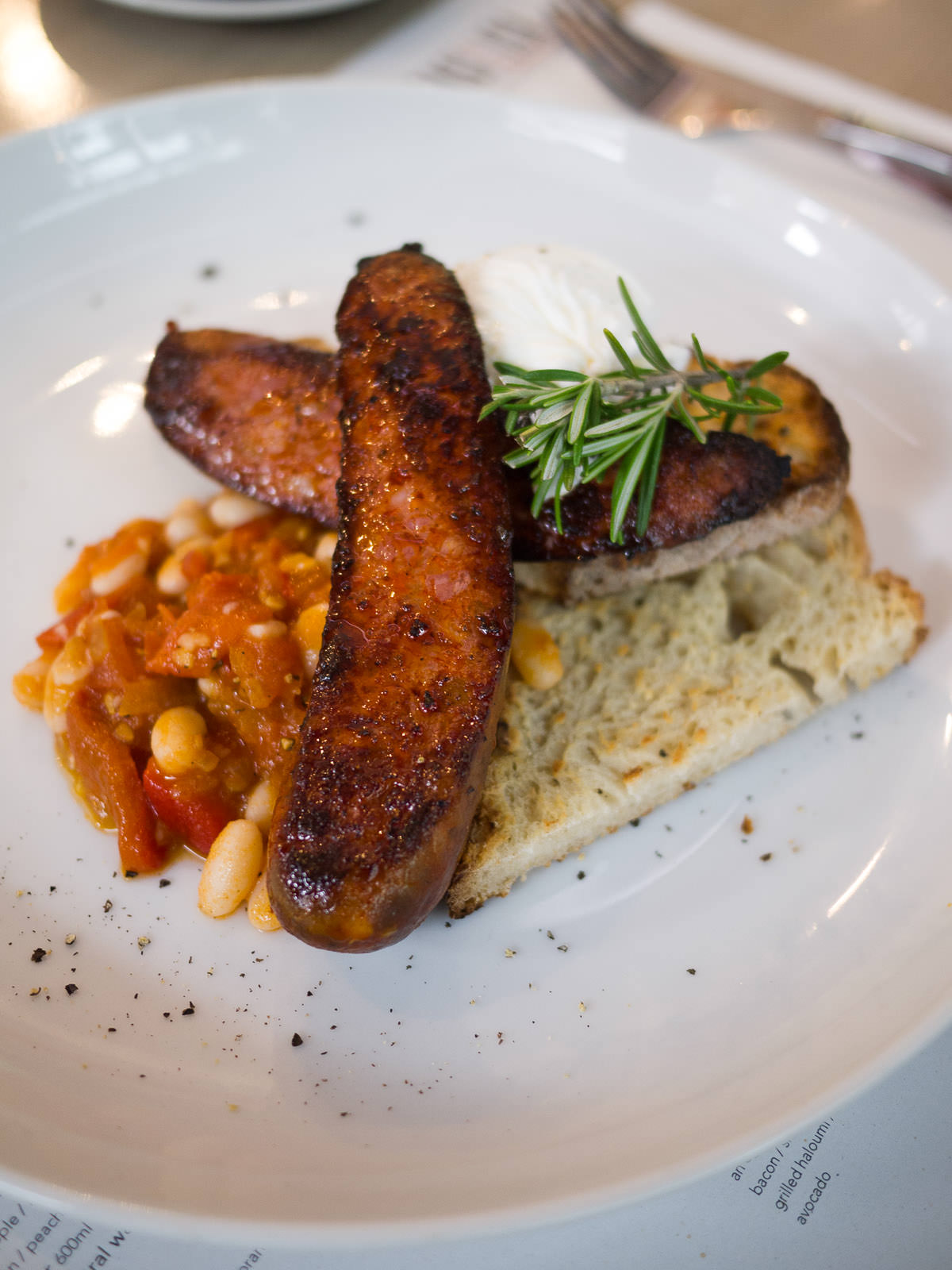 Grilled chorizo with cannellini beans, poached egg and sourdough (AU$17.50)