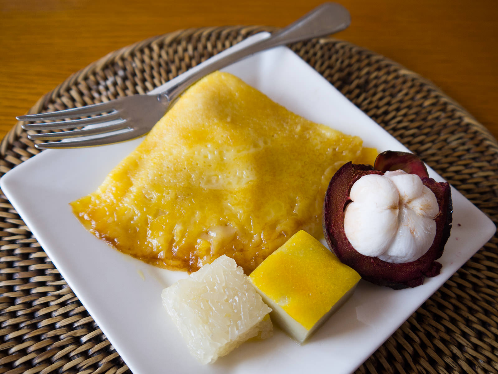 Crepe with orange sauce, Vietnamese sticky rice cakes, mangosteen