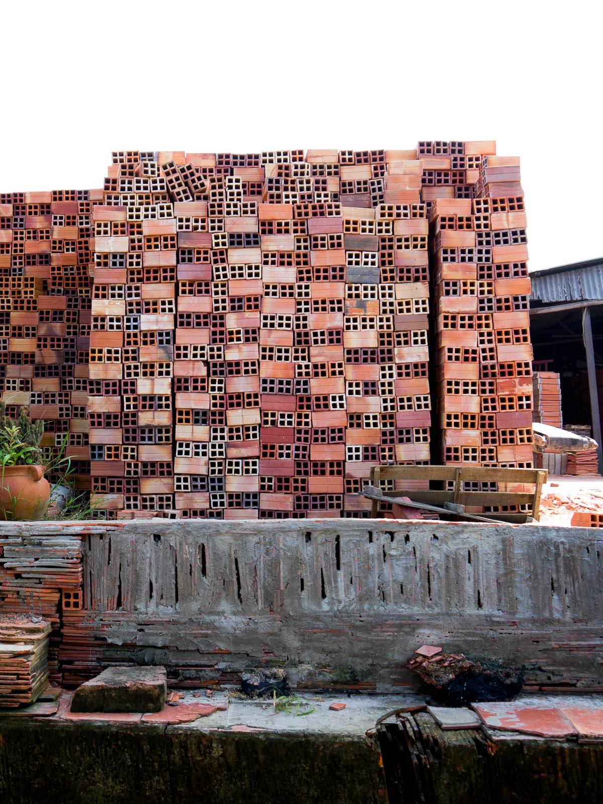 Piles of bricks at the brick factory in Sa Dec.