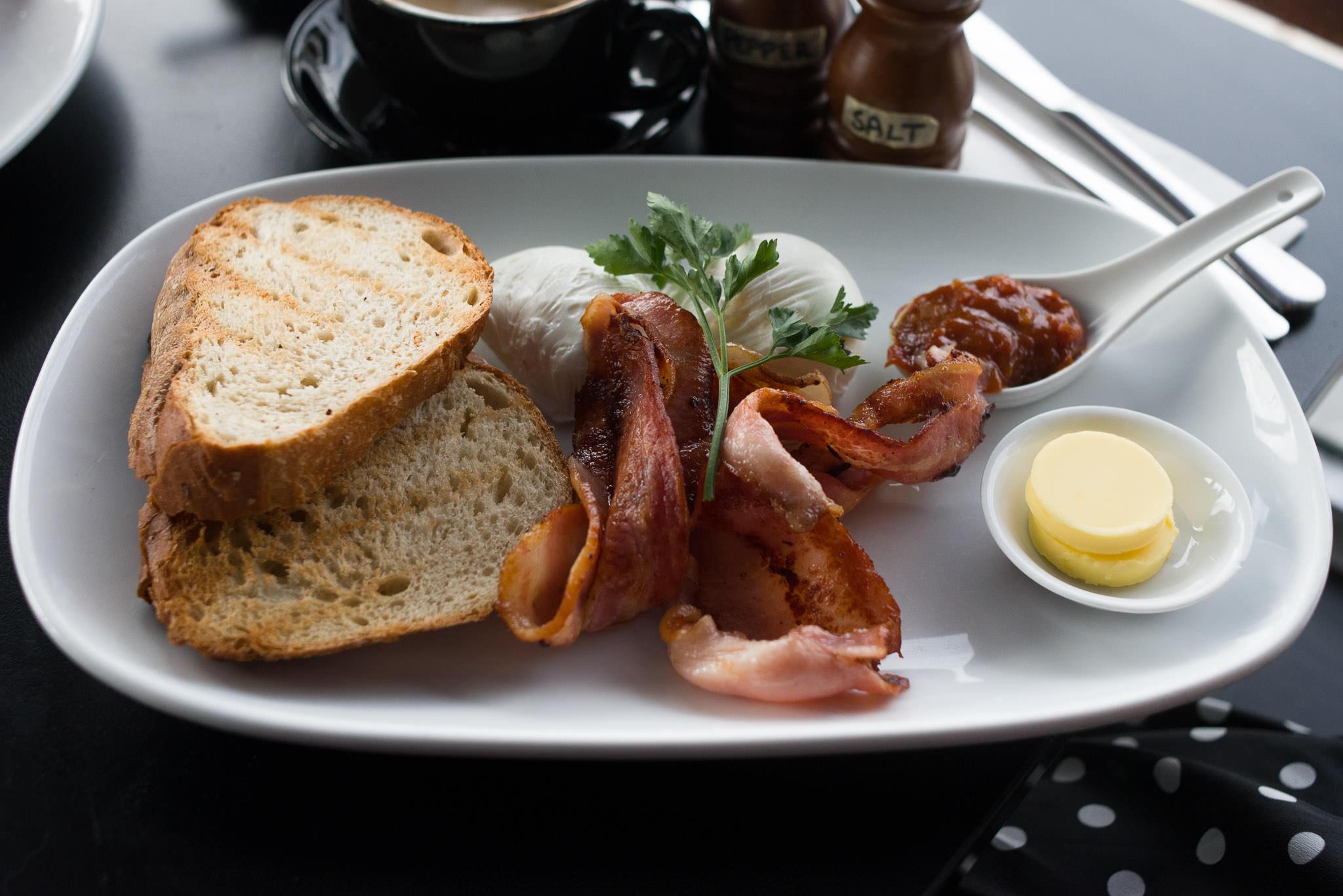 Poached eggs on toast (AU$11) plus a side of bacon (AU$5.50)