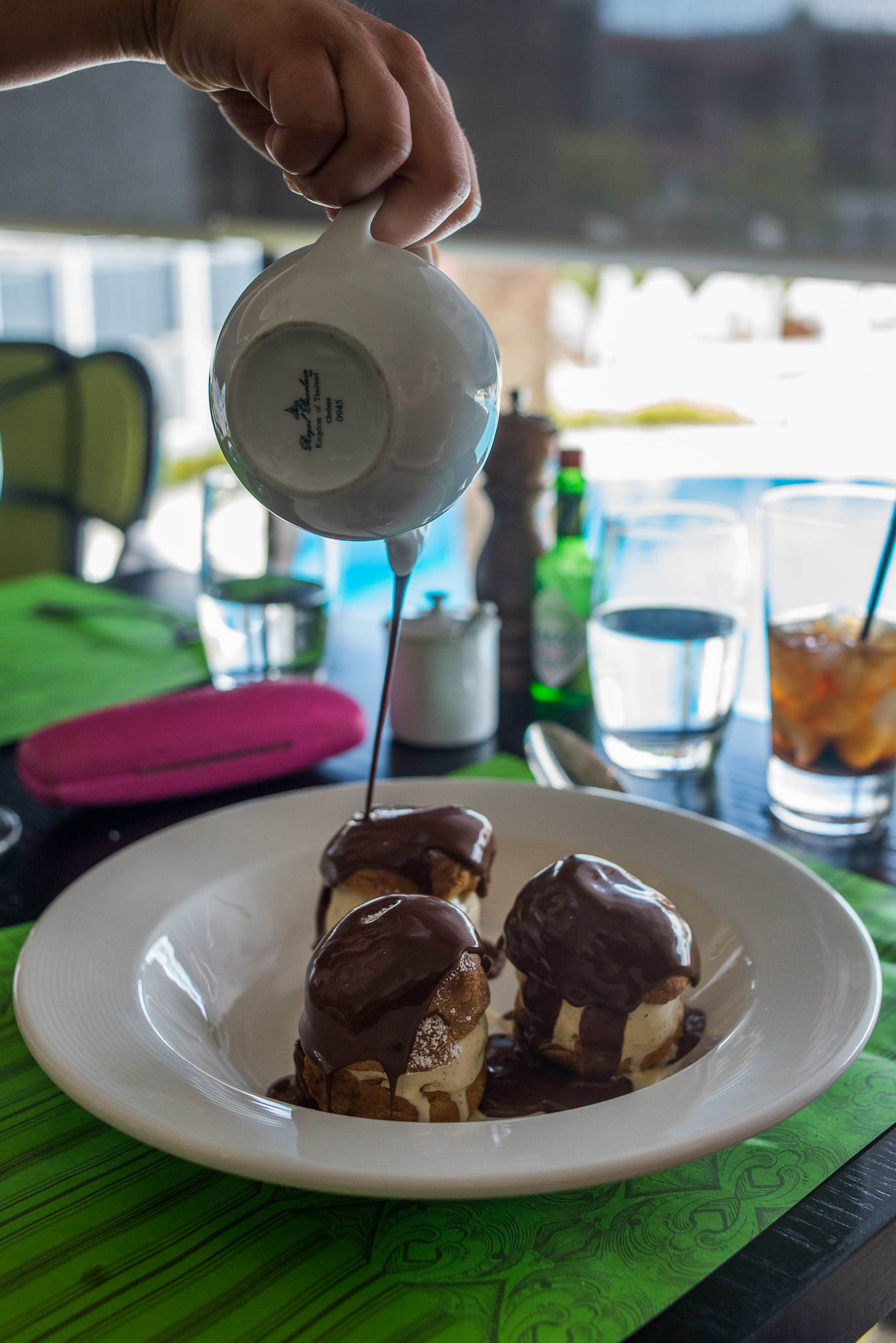 Profiteroles with vanilla bean ice cream and warm chocolate sauce (AU$18)