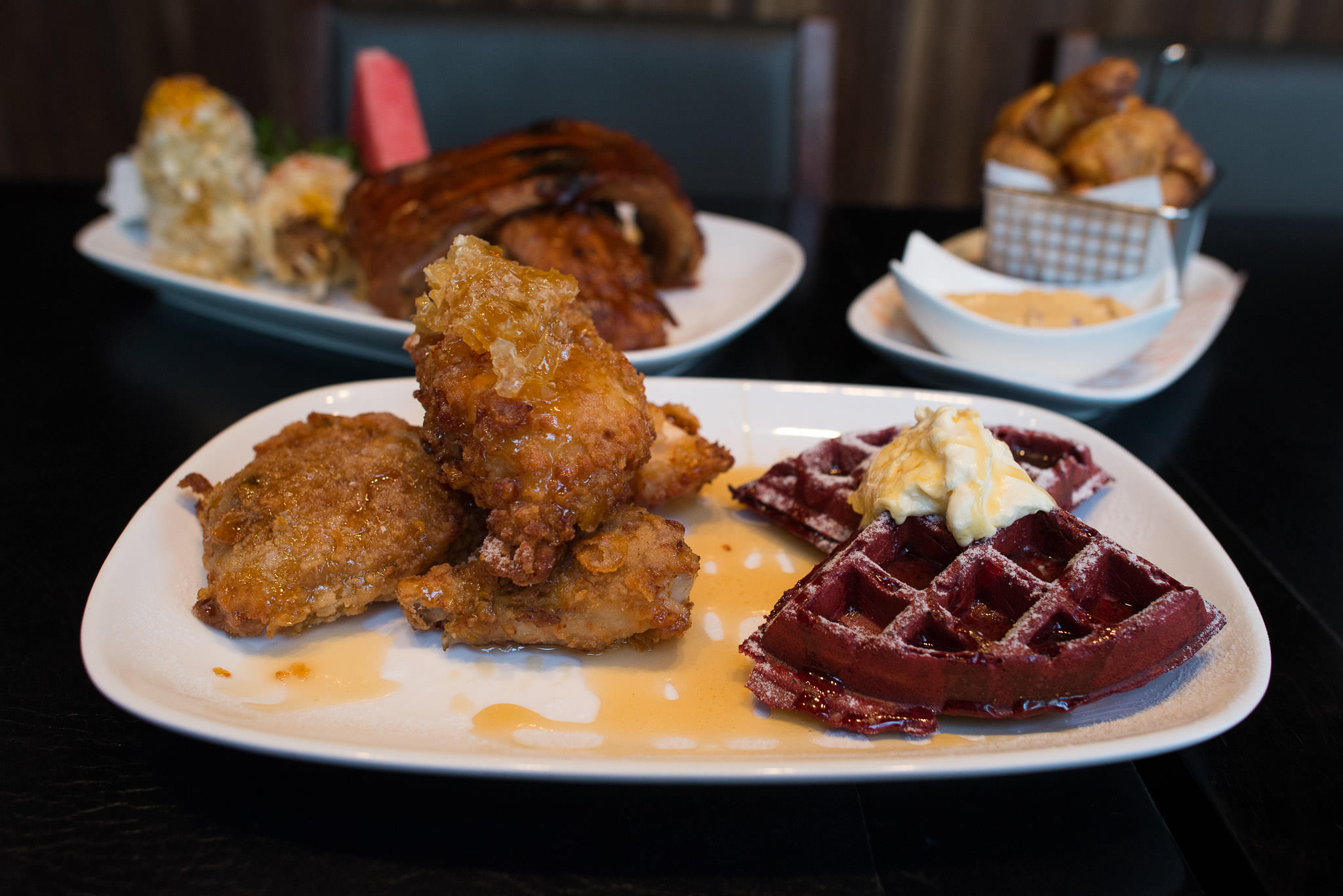 Fried chicken and red velvet waffles with Killer Bee honey (AU$28)