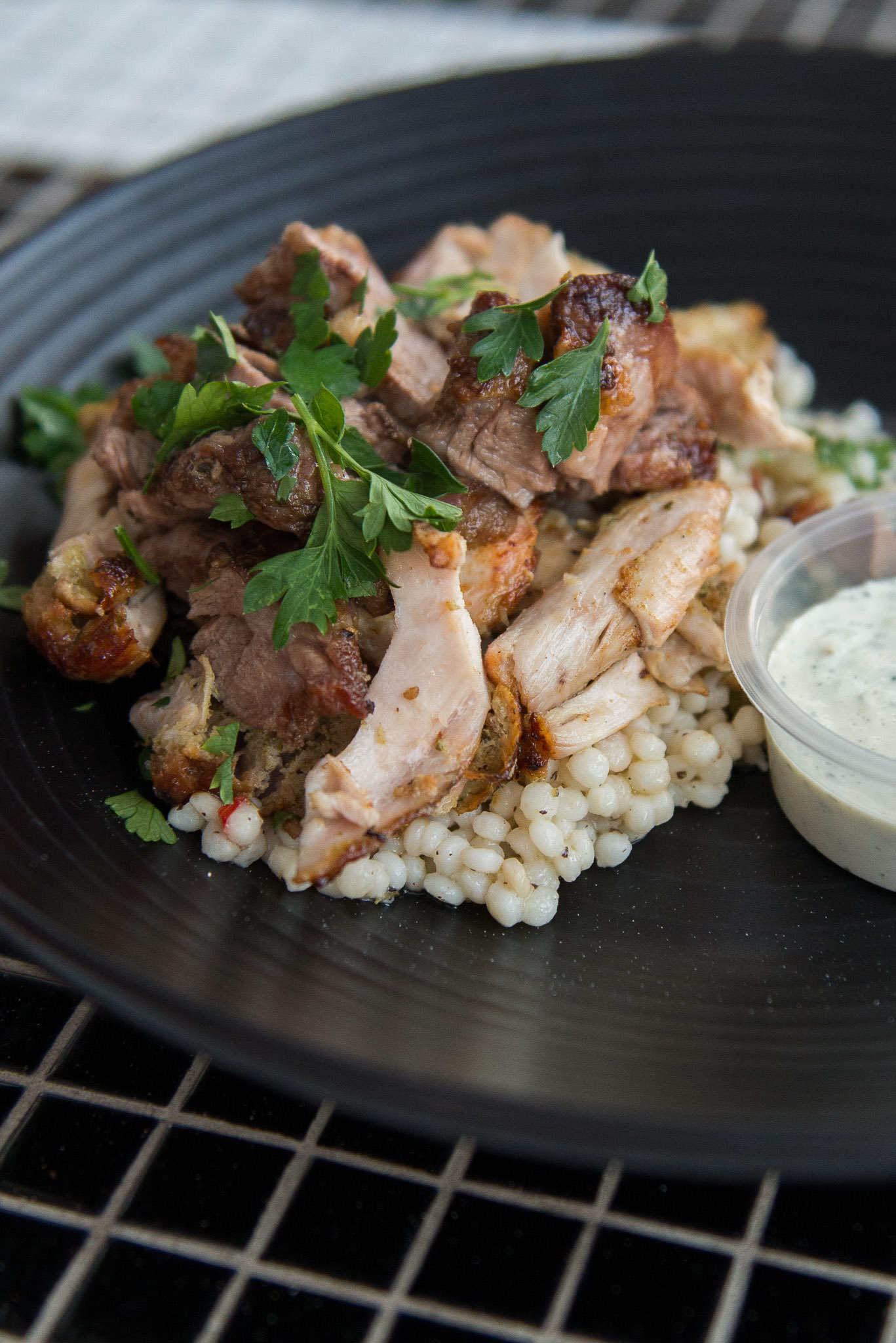 Marinated Arkady Margaret River lamb and Mount Barker chicken, cooked over charcoal, served with tzatziki and giant couscous (AU$27)