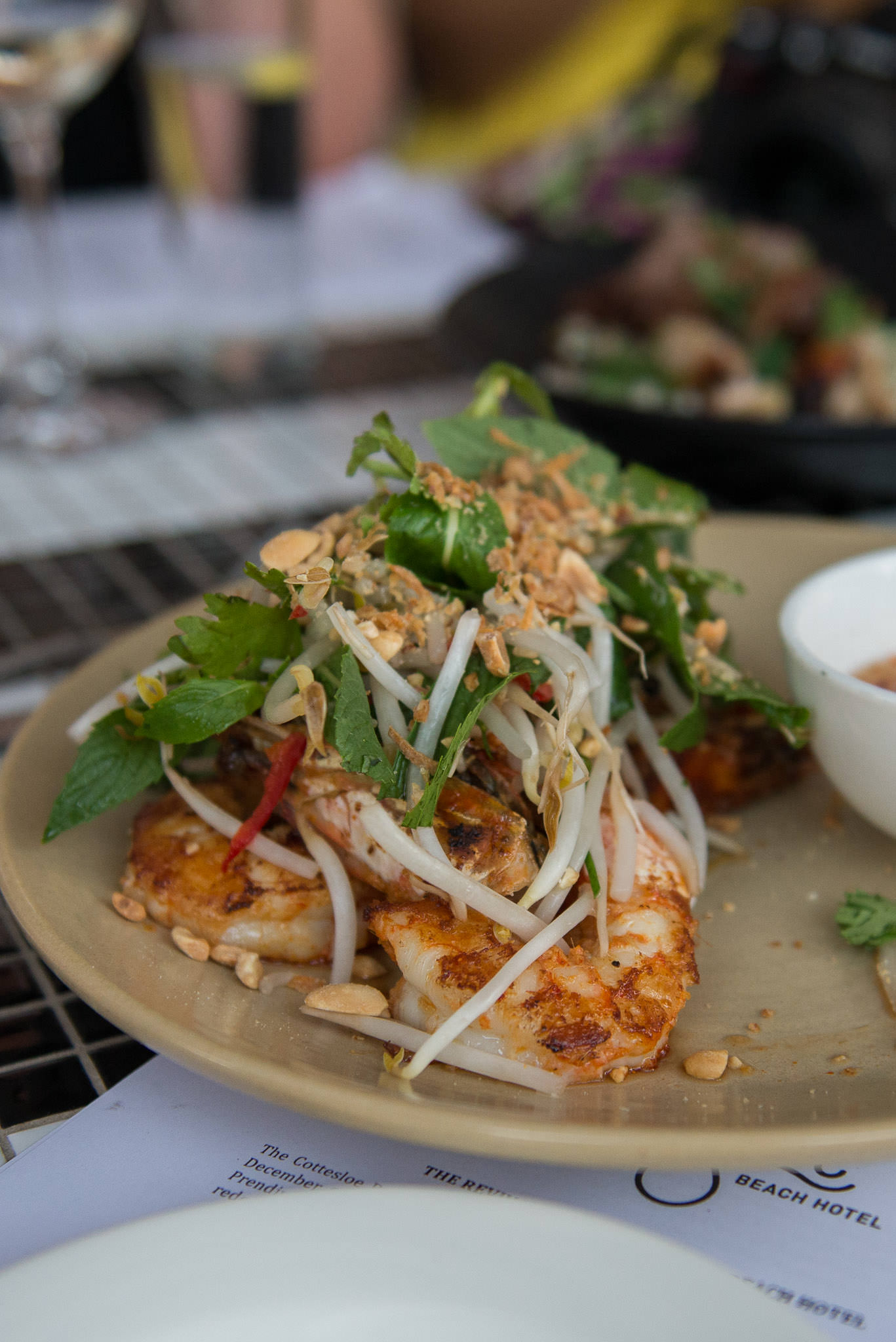 Grilled Carnarvon tiger prawns, pineapple, chilli & lime salsa, bean sprout salad (AU$34)